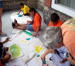 children painting with instructor