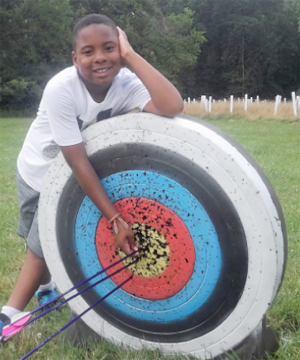Terrence showing archery skills.